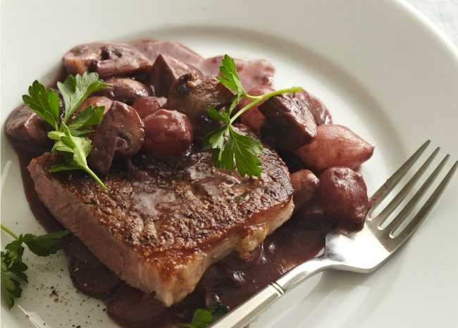 Steak with mushroom and red wine reduction