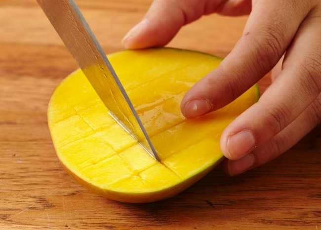 Slicing the mango into squares
