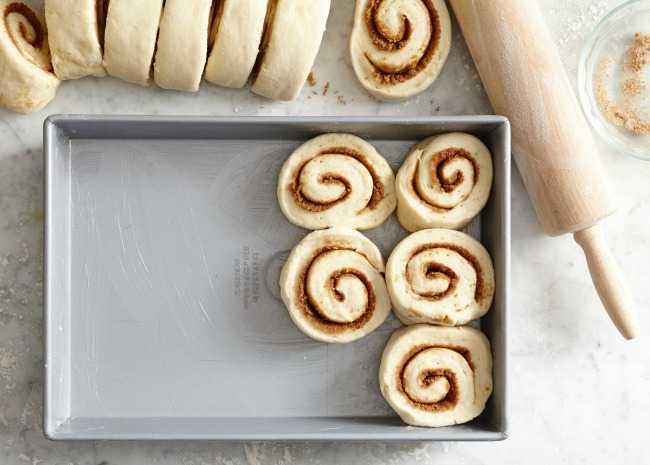 Placing Cinnamon Roll Dough in a Baking Pan