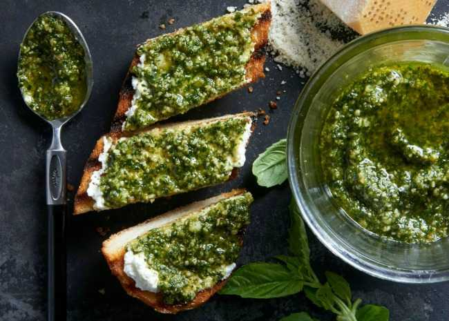 Pesto in dish and spread on toast