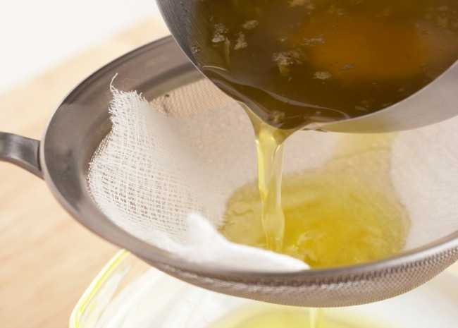 Pouring Clarified Butter Through Cheesecloth