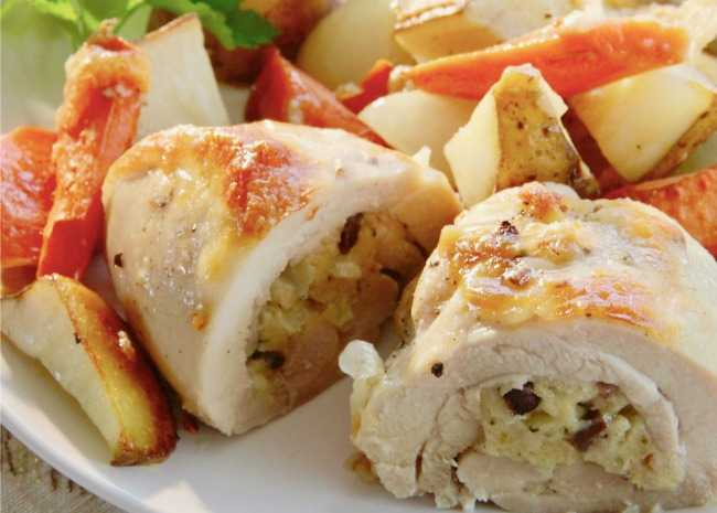 4458935-stuffed-chicken-thighs-with-roasted-potatoes-and-carrots-photo-by-lutzflcat-650x465