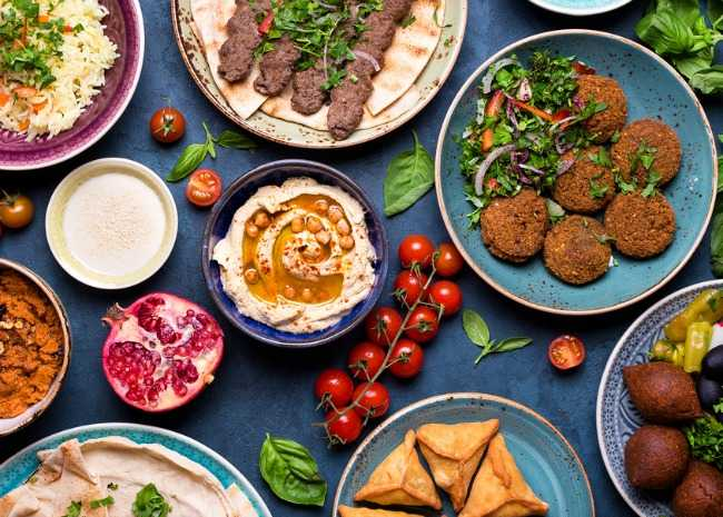 Plan a lebanese feast for your next dinner party allrecipes middle eastern or arabic dishes and assorted meze concrete rustic background meat kebab falafel baba forumfinder Gallery
