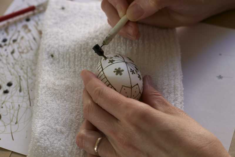 Outlining flower pattern in beeswax