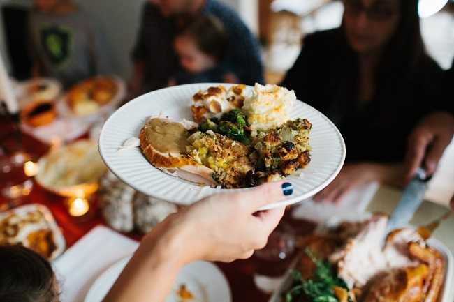 edited Holding-a-Plate-of-Thanksgiving-Dinner-1024x683