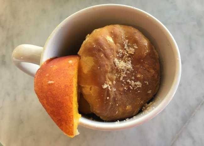 edited peach cobbler in a mug